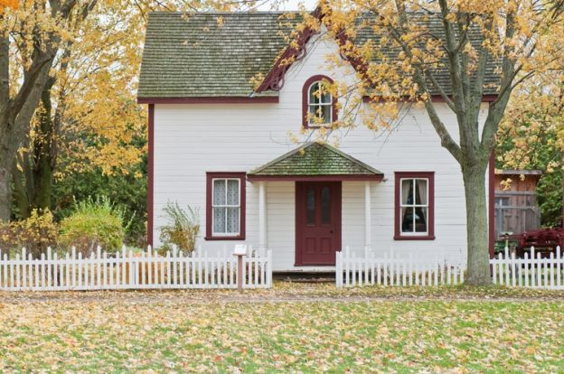 radon-resistant white house under a maple tree
